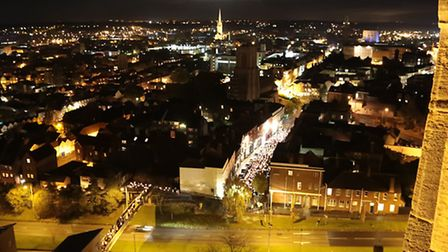 The candle-light procession stretching over Grapes Hill Bridge and Upper St. Giles. Picture: Paul H