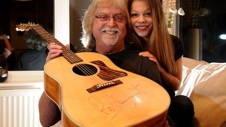 Barry Holden, from North Walsham, pictured with his granddaughter Daisy and the guitar signed by Rod