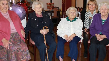 Sheringham 100-year-old Maude Hewitt with (back from left) fellow centenarian Frances Stephen, 101-y