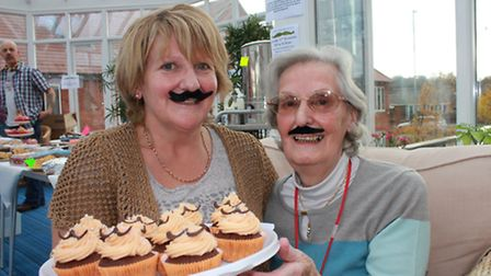 Halsey House staff nurse Hilary Anderson and resident Sylvia Goddard, 81, join in the Movember fun.