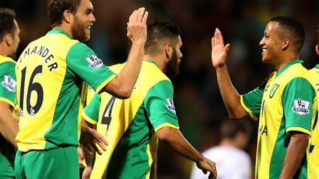 Norwich City's on-loan striker Johan Elmander and Martin Olsson must overcome their World Cup disappointment. Picture...