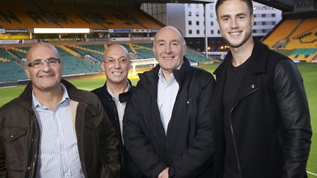 Norwich City Striker and the three Anglian Home Improvements staff who each have 40 years of service