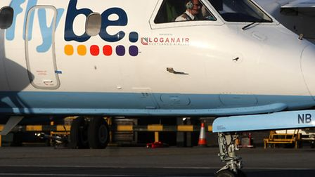 A pilot completing final checks on a Flybe plane as the struggling regional airline has warned that