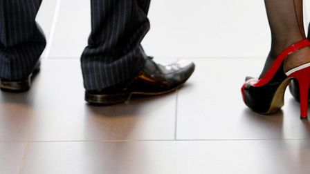 File photo dated 15/09/09 of the shoes of a man and a woman as most people say it does not matter if