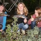 Intrepid hunters with models of the Spanish slugs in the Hethersett garden featured in Countryfile p