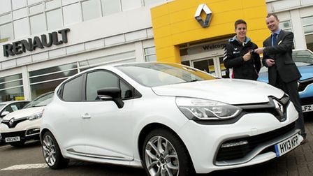 Josh Files, left, receiving the keys to his new Clio Renaultsport 200 Turbo EDC road car from Holden