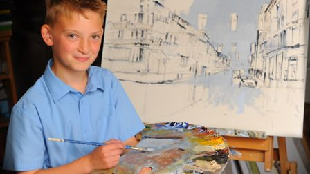 Kieron Williamson painting at his Ludham home. His latest painting is of Portland Street in London i