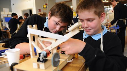 Students work on their vehicles for the inter schools engineering challenge at Hellesdon High School