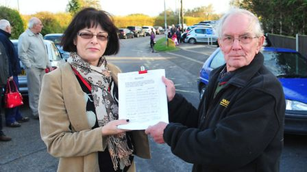 Frank Nicholls along with other residents hands over a petition to Suffolk Cllr Sonia Barker to impr