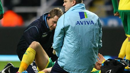 Norwich City midfielder Anthony Pilkington is treated after suffering a hamstring injury in the club