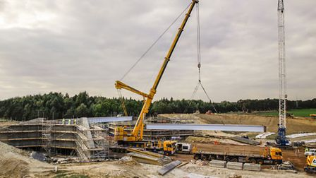 Contractors install a new bridge for the B1106 over the A11