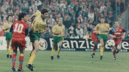 Chris Sutton in action for Norwich City against Bayern Munich in the club's famous 2-1 UEFA Cup win