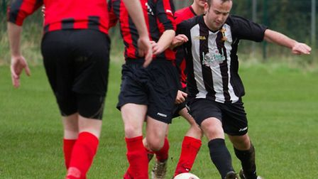 Will Guy (right) standing strong for Swaffham Town A against Rockland United. Picture: Eddie Deane.