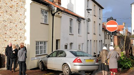 The car which rolled into a house in Cromer after the driver left the handbrake off.PHOTO: ANTONY KE