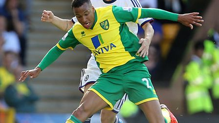 Norwich City's Martin Olsson (left) and Chelsea's Emboaba Oscar battle for the ball during the Barcl