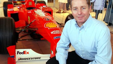 Former F1 driver and now Formula One Commentator Martin Brundle, with Michael Schumacher's winning F