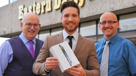Ben Adams of BB Adams with the Ipad on offer to one of the EDP's twitter followers. Pictured with Ed