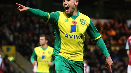 Gary Hooper celebrates what he will hope is the first of many Premier League goal in Norwich City's