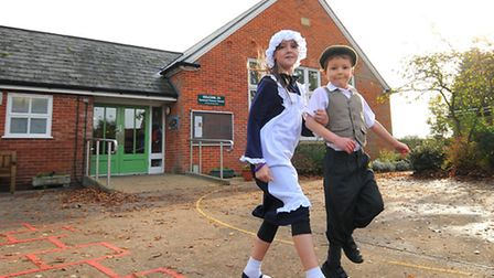 Tunstead School staff and pupils celebrating the centenary. Pupils Lacey MacKenzie 10 and Charlie Pa