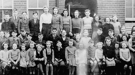 Tunstead School staff and pupils celebrating the centenary. A school photograph taken in 1947/8.PHOT