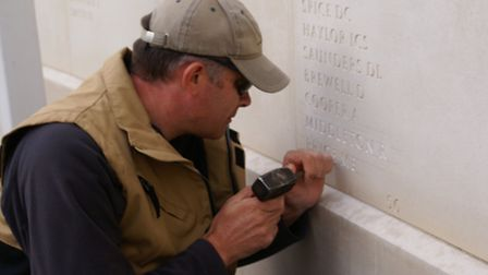 Nick Hindle adds names to the Armed Forces Memorial.