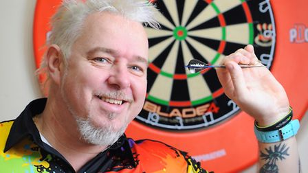 """Peter """"Snakebite"""" Wright who is taking part in the World Championship Darts competition. He is known"""