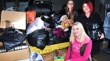 Michele Blatchford, Danielle Bailey (sitting) and Carly Byham with a collection of goods that has be