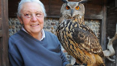 Bev Cosse with an eagle owl at the Sea and Bird Rescue Trust where she as chairman. Picture: JAMES B
