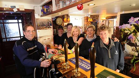 The King's Arms in Blakeney is up and running again after the flooding. Left to right, John Marcucci