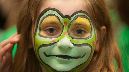 A pupil appearing in Aldborough Primary School's panto, the Frog Prince