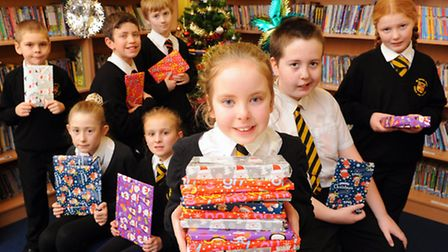 Pupils from St Nicholas Priory Junior School receiving book gifts from the school to help boost lite
