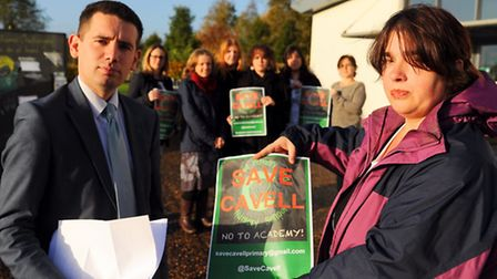 Simon Wright MP, chats with one of the campaign organisers, Tina Boulter, front, as concerned parent