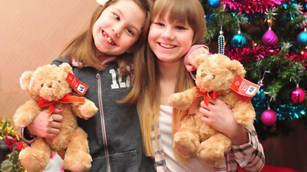 Charley Robbins,10, from Gorleston at home with her gifts donated by local police officers after she