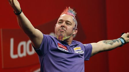 Peter Wright celebrates his victory against Simon Whitlock during day fifteen of The Ladbrokes World