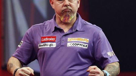 Peter Wright celebrates whilst competing against Simon Whitlock during day fifteen of The Ladbrokes
