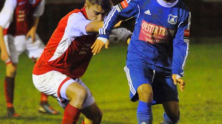 Wroxham's Fernando Vide (blue) in action during Wroxham's 5-2 defeat to Needham Market at Trafford P