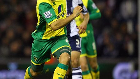 Norwich City midfielder Bradley Johnson admits the Canaries' squad is well used to being written off