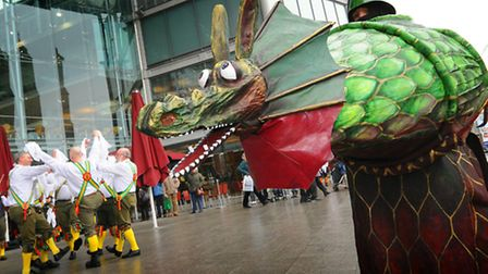 Morris dancers and their Dragons perform outside the Forum as part of a previous Dragon Festival.