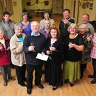 Tony Fox (centre) retires from caretaker of Blundeston village Hall father 35 years.
