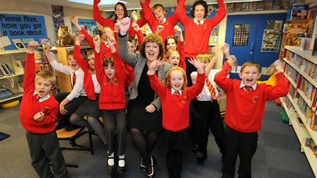 Stalham Junior School headteacher Kim Breen and pupils celebrating the school's improved Ofsted repo
