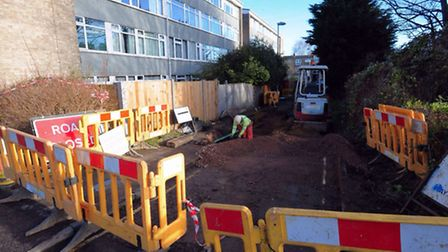 The burst water main at Portway Place in Norwich which damaged nearby homes.PHOTO BY SIMON FINLAY