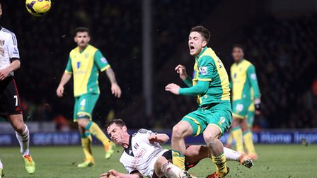 Fulham match-winner Scott Parker takes no prisoners with a crunching tackle on Norwich City's Ricky