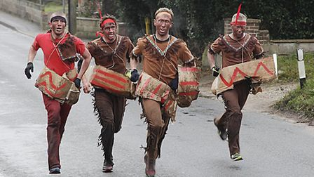Runners dressed as Red Indians in the Hare and Hounds Boxing Day Run. Pic: Bob Clarke.