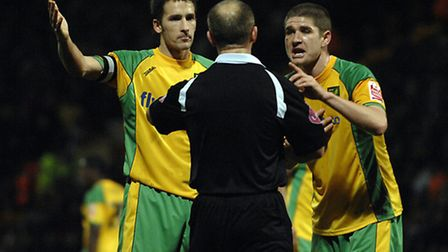 Norwich City v Sheffield Wednesday.Adam Drury (left) and Carl Robinson talking to the referee about
