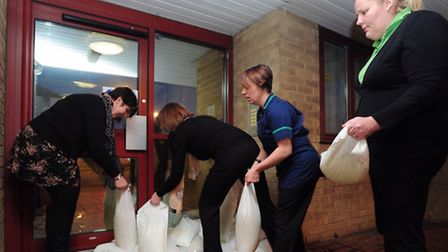 Staff at Levington Court in Lowestoft prepare for potential flooding by moving furniture and placing