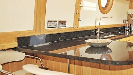 This is a very smart looking galley, with seemingly acres of granite worktop