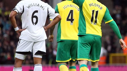 Norwich City striker Gary Hooper raises his arm in celebration after a stunning strike in Sunday's 1