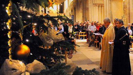 The Marie Curie Cancer Care Lights to Remember service at Norwich Cathedral. The lighting of the Tre