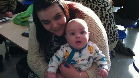 Caister High School rest centre. Laura Simnett, 20, with son Jaydn, six months, of Harley Road, Grea