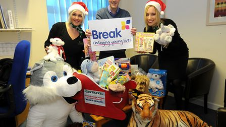 Staff from CAS Travel hand over a donation of Christmas presents to Break Charity. Left to right, Jo